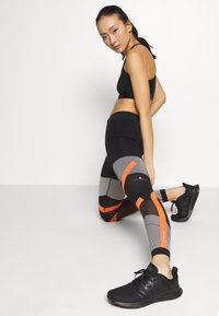 adidas Performance - PARLEY PRIMEKNIT RUNNING HIGH WAIST LEGGINGS - Tights - black/white/orange - 1