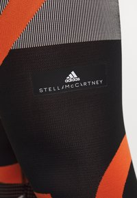 adidas Performance - PARLEY PRIMEKNIT RUNNING HIGH WAIST LEGGINGS - Tights - black/white/orange - 6