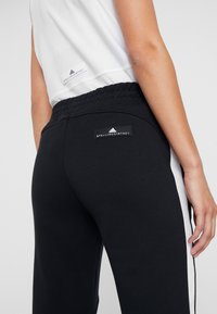 adidas Performance - KICK SPORT WORKOUT TRACK PANTS - Tracksuit bottoms - black - 5
