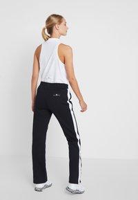 adidas Performance - KICK SPORT WORKOUT TRACK PANTS - Spodnie treningowe - black - 2