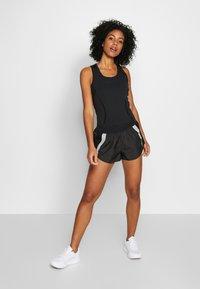 adidas by Stella McCartney - SHORT - Sportovní kraťasy - black - 1