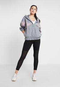 adidas by Stella McCartney - ATHLETICS PULL ON SPORT LIGHT JACKET - Training jacket - grey - 1
