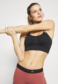 adidas by Stella McCartney - SEAMLESS BRA - Sports bra - black/solgre - 0
