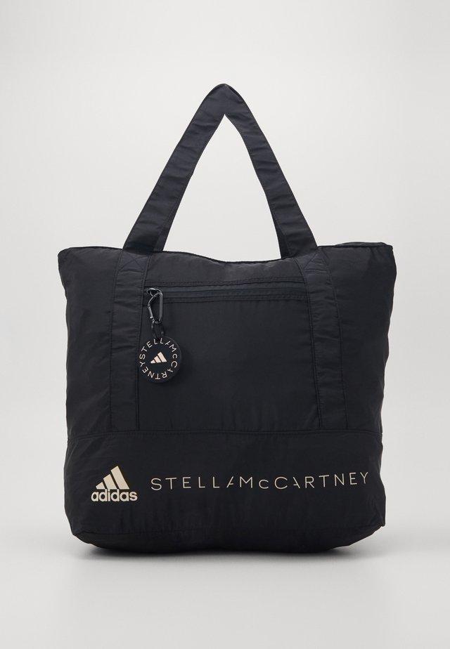 MEDIUM TOTE - Sports bag - black/white
