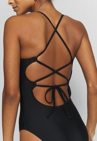 aerie - ONE PIECE STRAPPY BACK BASIC SOLID - Maillot de bain - true black - 5