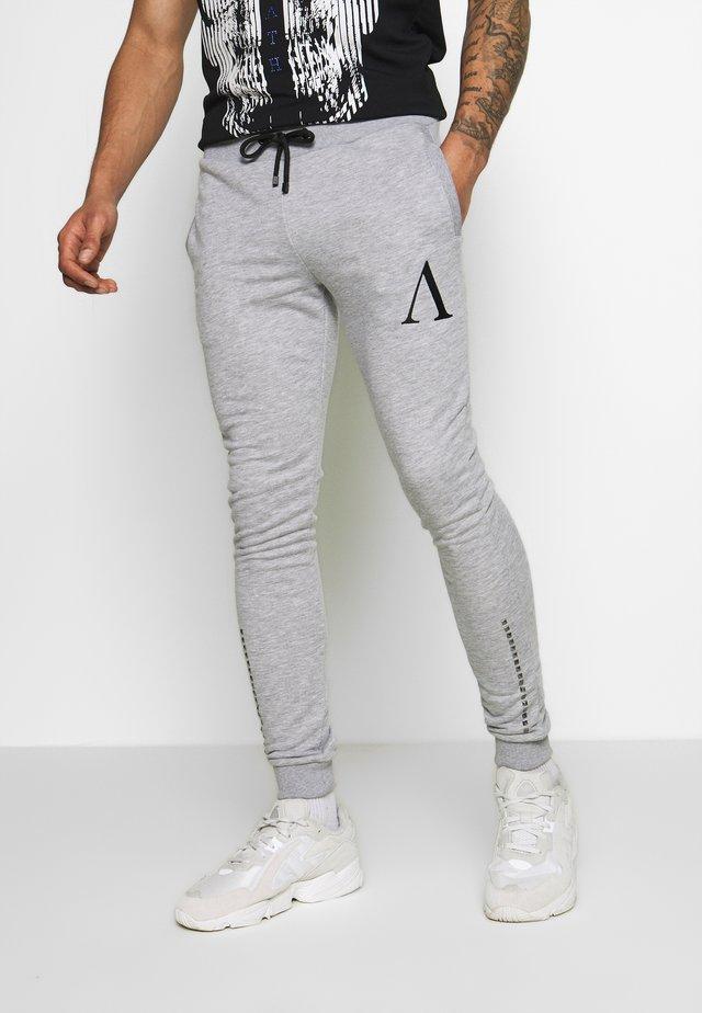 COPPAN - Spodnie treningowe - grey
