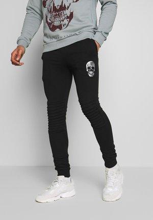 SMITH - Teplákové kalhoty - black