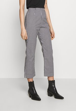 RYDER - Trousers - black/white