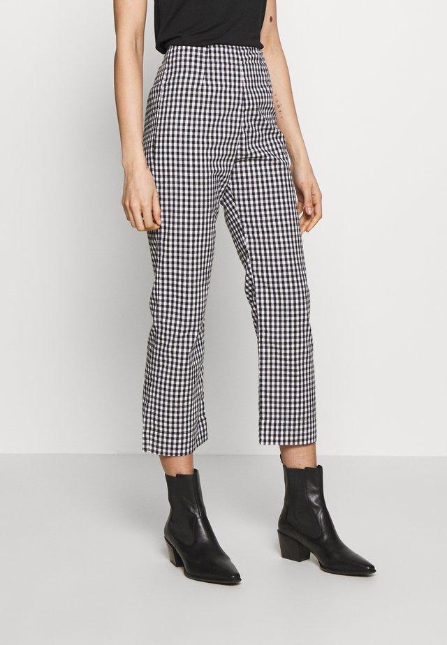 RYDER - Spodnie materiałowe - black/white