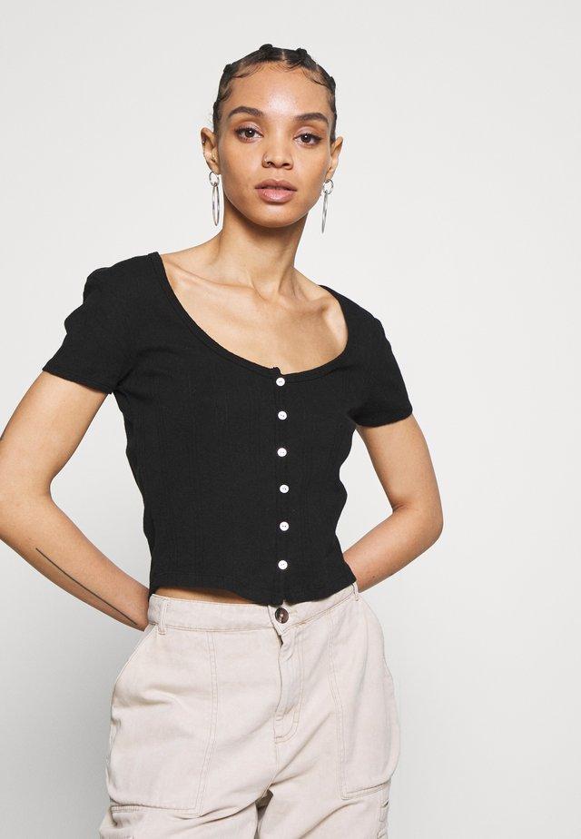 PATTI - T-shirt imprimé - black