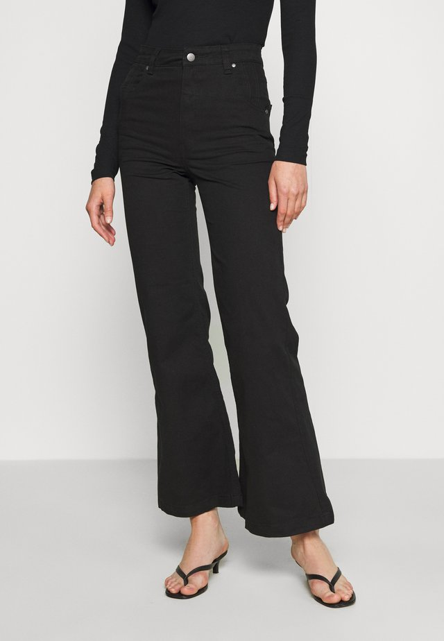 MARSHA - Flared jeans - black