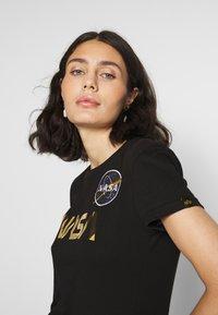 Alpha Industries - NASA - T-shirt print - black/gold - 5
