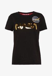 Alpha Industries - NASA - T-shirt print - black/gold - 4
