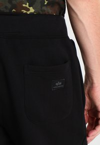 Alpha Industries - X FIT PANT - Jogginghose - black - 4