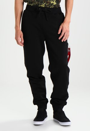 X FIT PANT - Verryttelyhousut - black