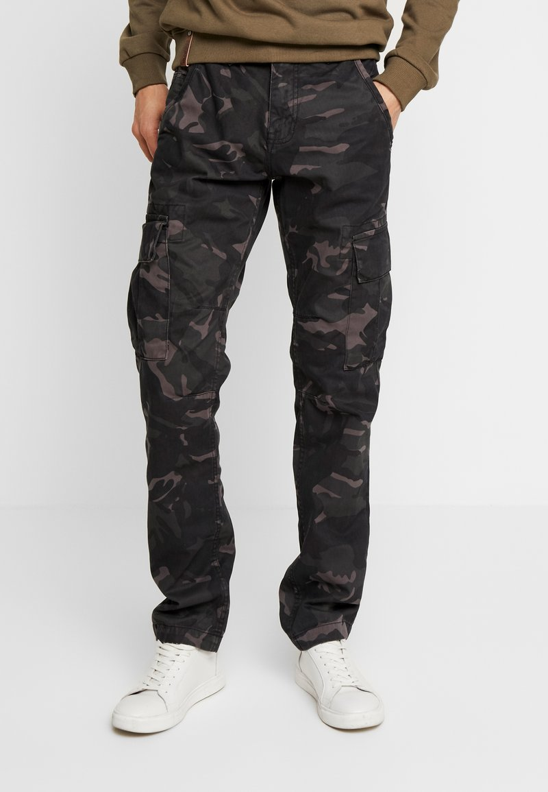 Alpha Industries - Pantalones cargo - black camo