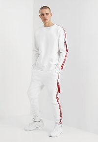 Alpha Industries - JOGGER TAPE - Tracksuit bottoms - white - 1