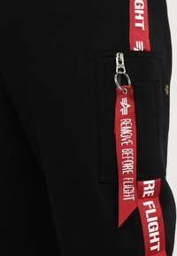 Alpha Industries - JOGGER TAPE - Verryttelyhousut - black - 4