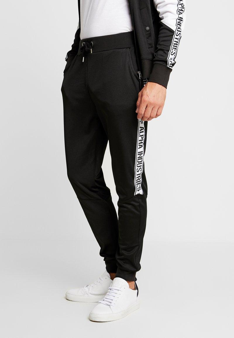 Alpha Industries - TRACK TAPE PANT - Pantalon de survêtement - schwarz