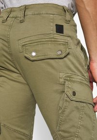 Alpha Industries - Pantalon cargo - oliv - 5