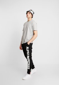 Alpha Industries - Jogginghose - black - 1