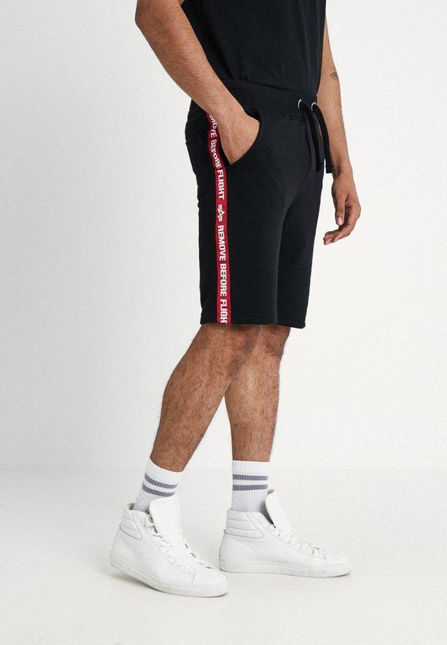 TAPE JOGGER - Teplákové kalhoty - black