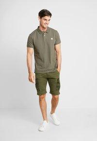 Alpha Industries - Shorts - dark olive - 1
