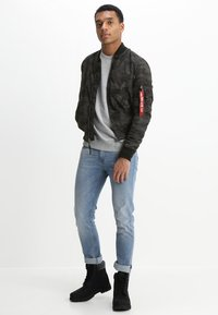 Alpha Industries - MA1 TT - Bomberjacks - black camo - 1