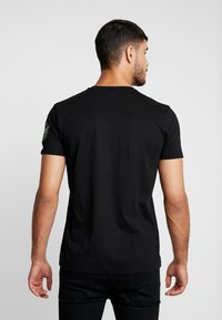 Alpha Industries - ANNIVERSARY CAPSULE - T-shirt print - black - 2