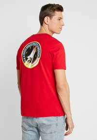 Alpha Industries - T-shirt con stampa - speed red - 2