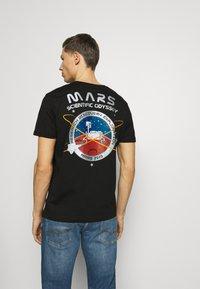 Alpha Industries - T-shirt imprimé - black - 0