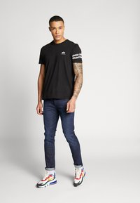 Alpha Industries - Camiseta estampada - black - 1