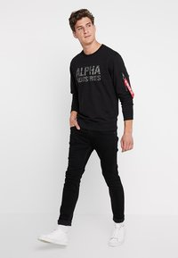 Alpha Industries - Sweatshirt - black - 1