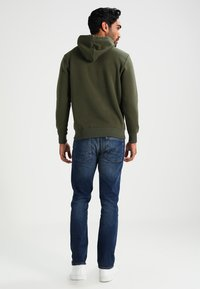 Alpha Industries - Hoodie - dark green