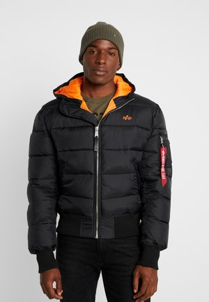 HOODED PUFFER - Winterjas - schwarz / orange