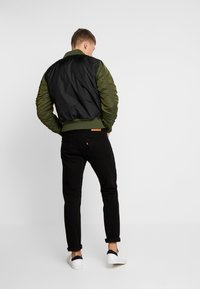 Alpha Industries - MA-1 ZIP HOOD - Bomberjacks - dark green