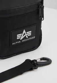 Alpha Industries - UTILITY BAG - Taška spříčným popruhem - black - 7