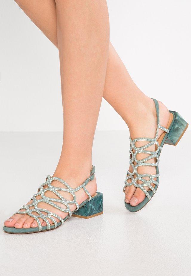 Sandaalit nilkkaremmillä - aqua
