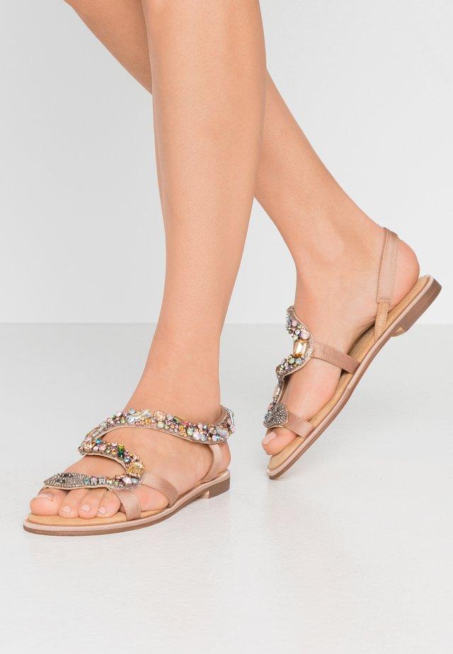 Sandaalit nilkkaremmillä - sand