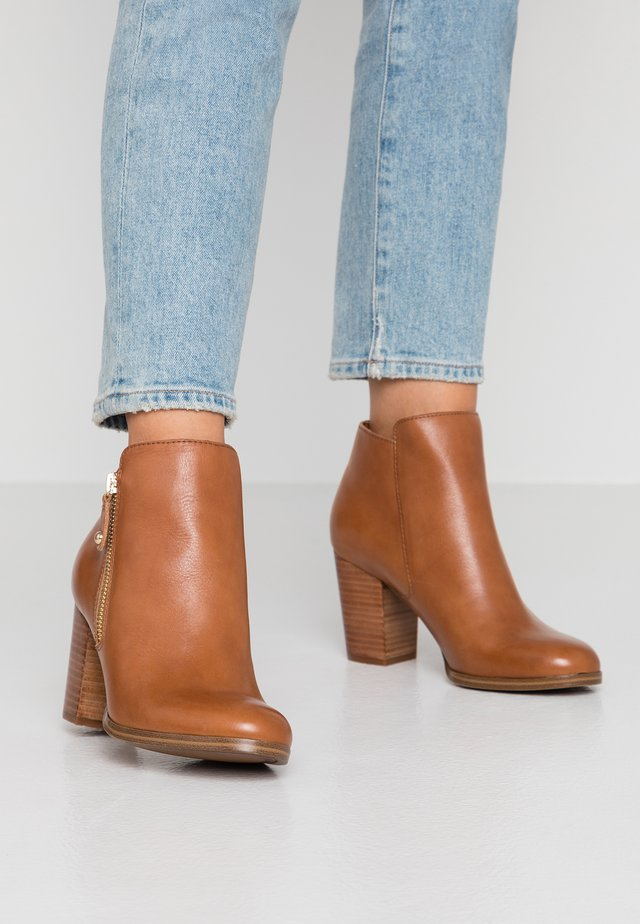 WIDE FIT NAEDIAW - Ankle boots - cognac