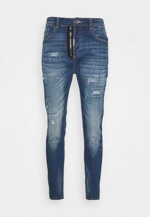 ZIPOLLO CARROT - Jeans fuselé - black