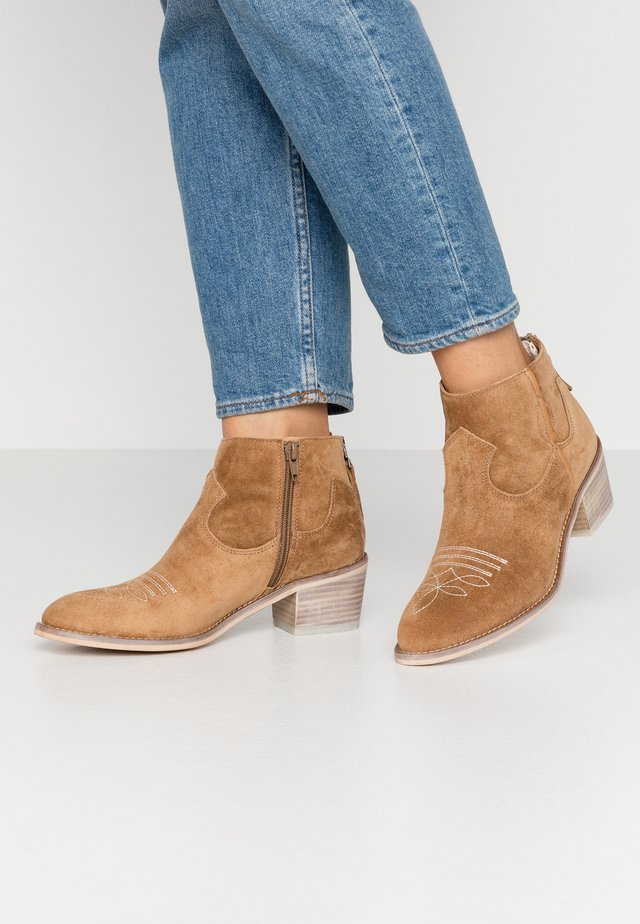 NELLY - Ankle boots - brown