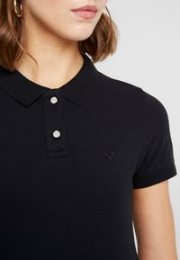 American Eagle - SOLIDS - Poloshirt - black - 4