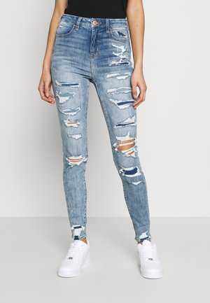 CURVY RISE - Jeans Skinny Fit - destroyed denim
