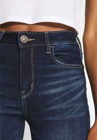 American Eagle - RISE JEGGING - Jeans Skinny Fit - blue denim - 4