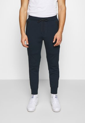 MANCHEGO TAPED  - Tracksuit bottoms - blue