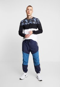 American Eagle - ACTIVE SIDE TAPE - Pantalon de survêtement - navy - 1