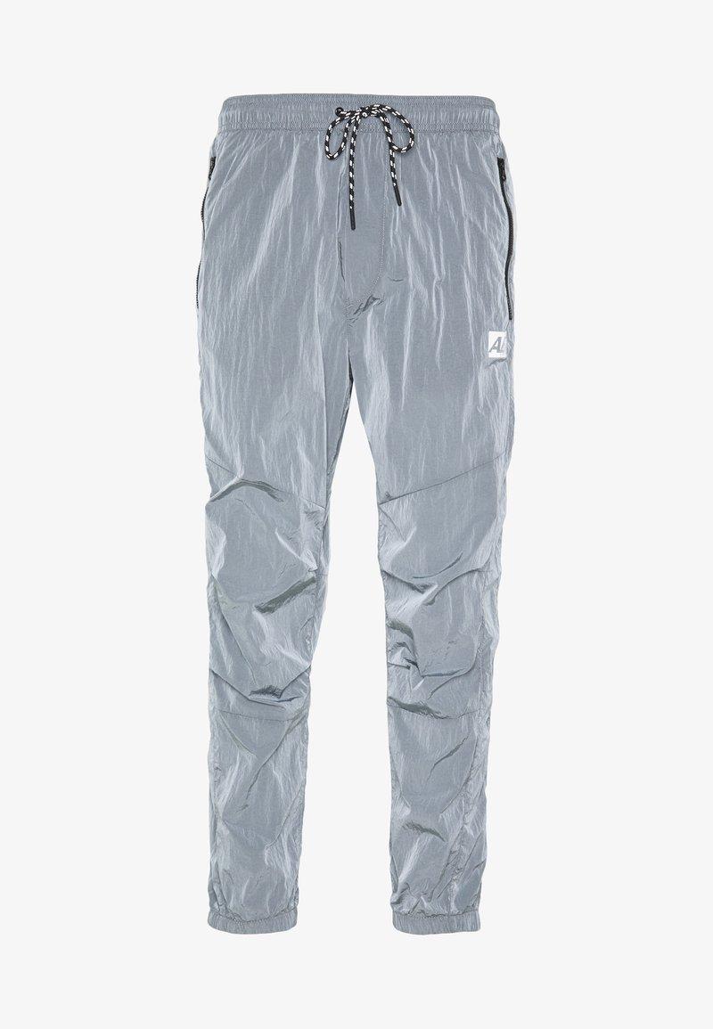 American Eagle - IRRIDESCENT NYLON JOGGER - Teplákové kalhoty - blue mist