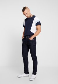 American Eagle - WASH - Jeans Skinny Fit - dark rinse - 1