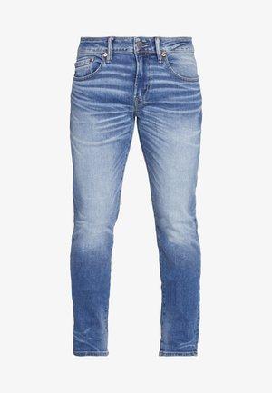 MEDIUM WASH TAPER - Slim fit jeans - medium bright indigo
